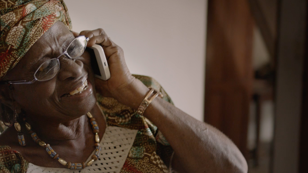 African grand mother on the phone