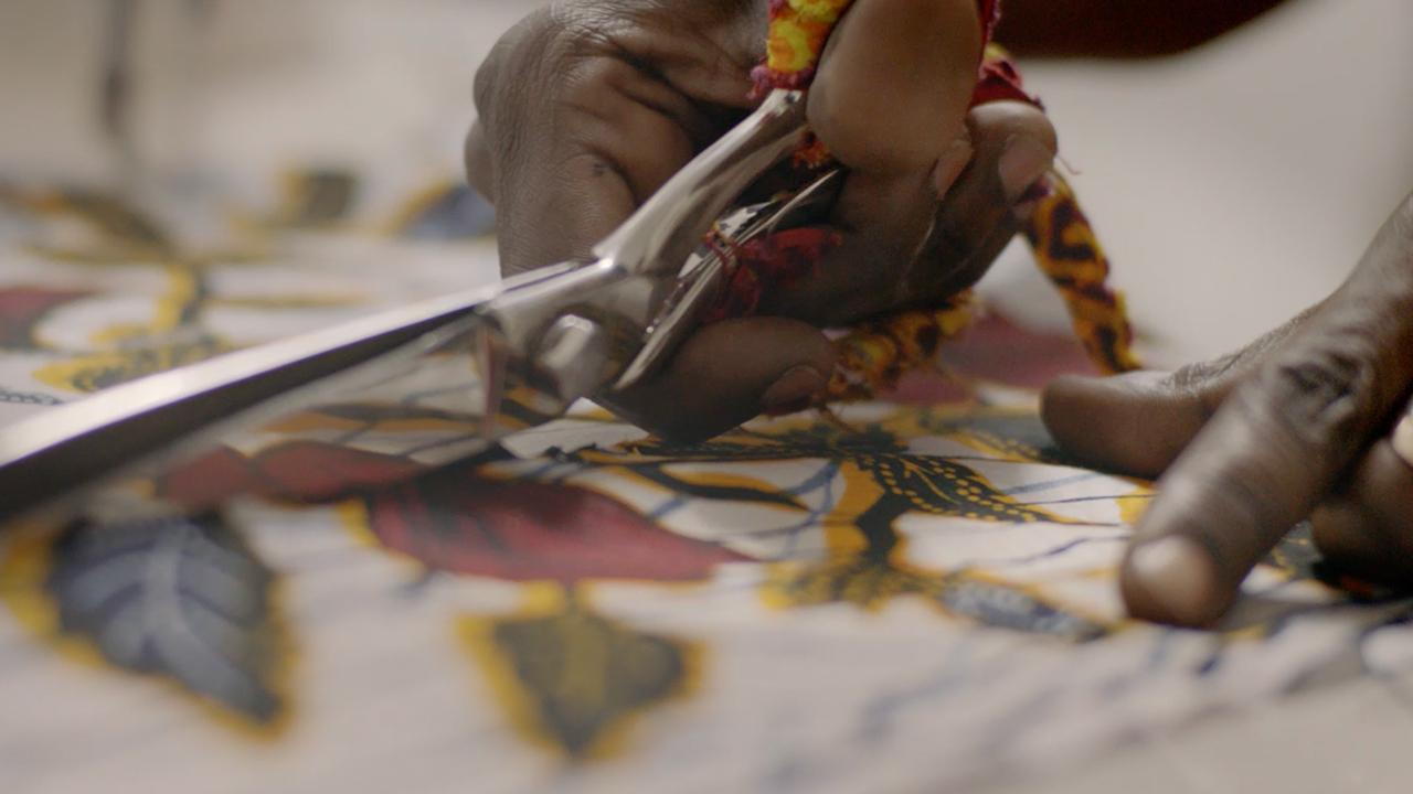 Woman knitting Vlisco fabric