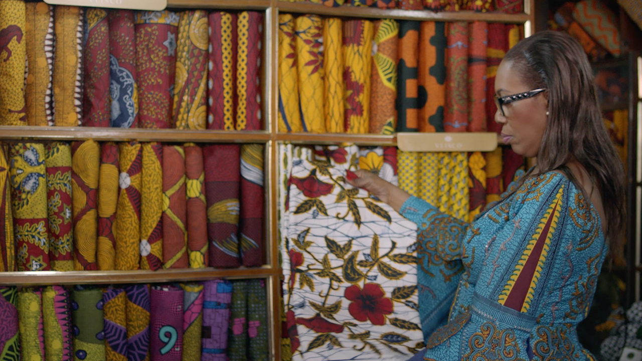 Woman picking Vlisco fabric