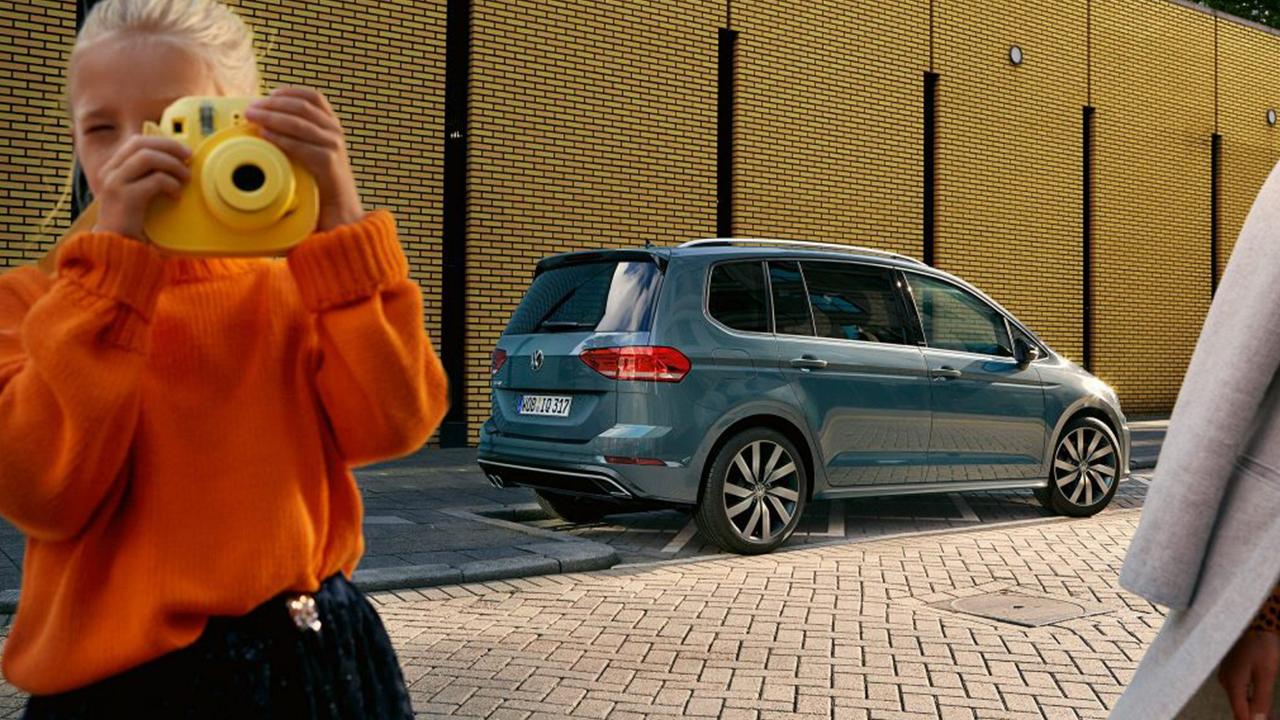 Kid next to Volkswagen IQ