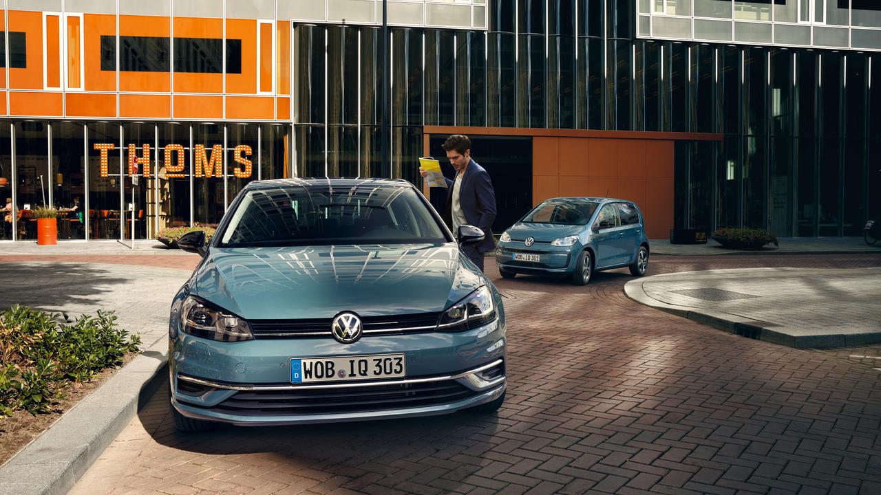 Man in front of Volkswagen IQ