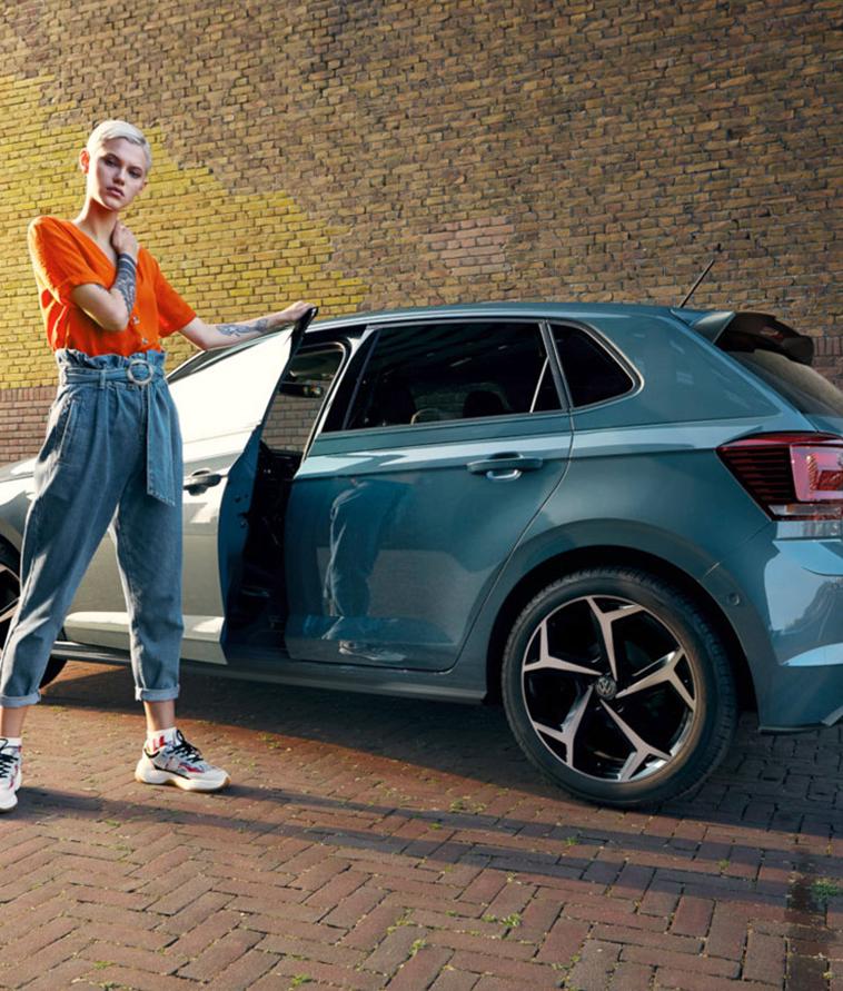 Girl next to Volkswagen