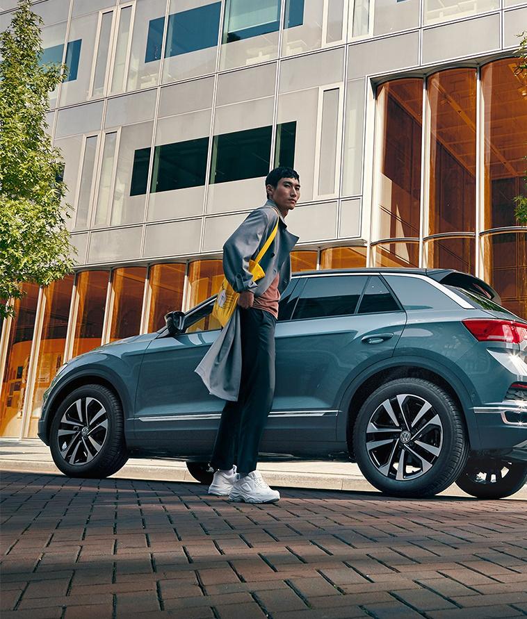 Guy in front of Volkswagen IQ