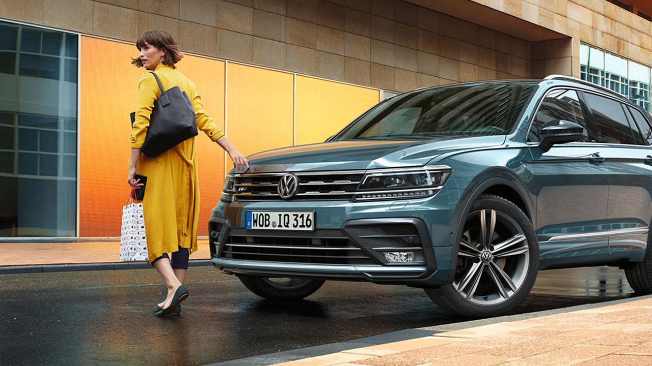 Girl next to Volkswagen IQ